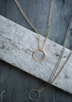 Circle pendant necklace on model