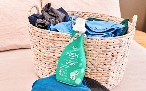 hex fabric conditioner bottle sitting on laundry