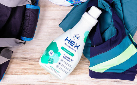 hex detergent sitting on athletic clothes