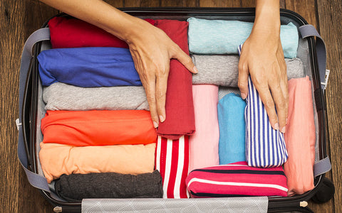 packing activewear into a suitcase for winter storage