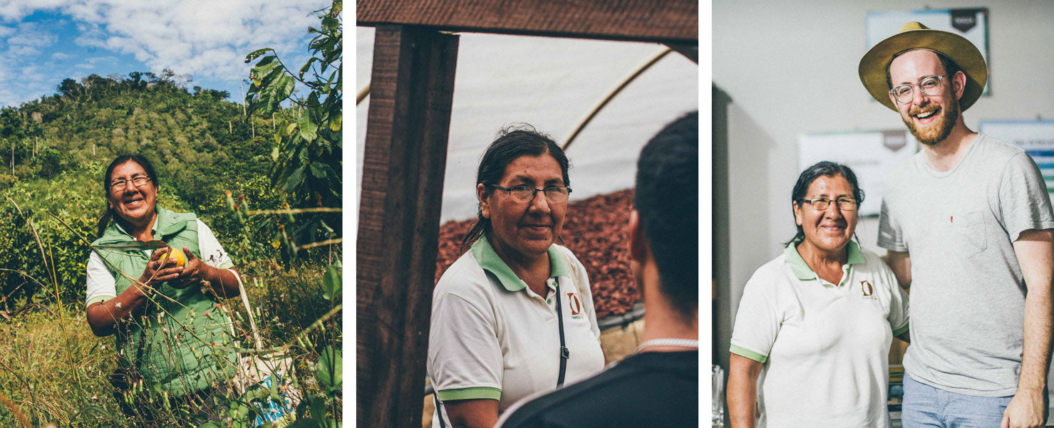 Esperanza Dionisio, Cooperative Director of CAC Pangoa, standing on a cacao farm, and smiling with Raaka co-founder, Nate Hodge.
