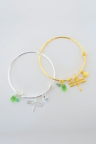 beck & boosh dragonfly bracelet in gold and silver adjustable cuff bracelet with delicate dragonfly charm and emerald green charms