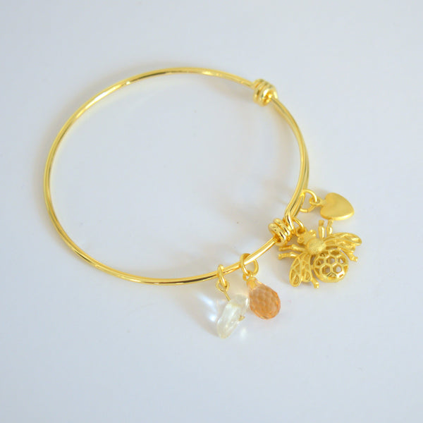 beck & boosh bumblebee bracelet in gold and silver adjustable cuff bracelet with delicate bumblebee charm and honey and amber charms