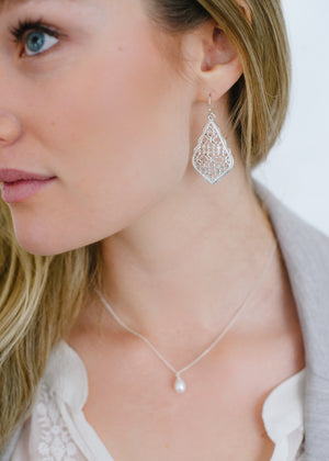 Beck & Boosh Filigree Earrings Scalloped edge with teardrop filigree design plated silver on model