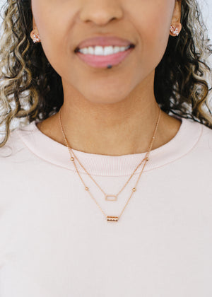 Beck & Boosh Double Fancy Necklace Two Chain One with Open Rectangle One with Four Circles In Rose Gold Stainless Steel On Model