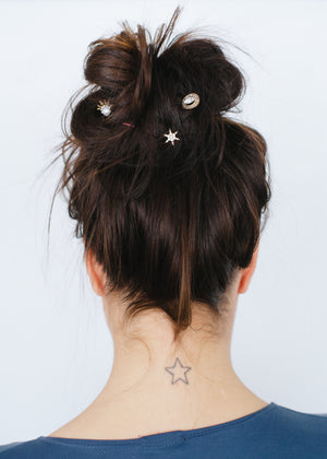 Beck & Boosh Celestial Hair Pin Set Variety of Four Arrow Circle Star Burst Rhinestone and Pearl Tarnished Gold On Model