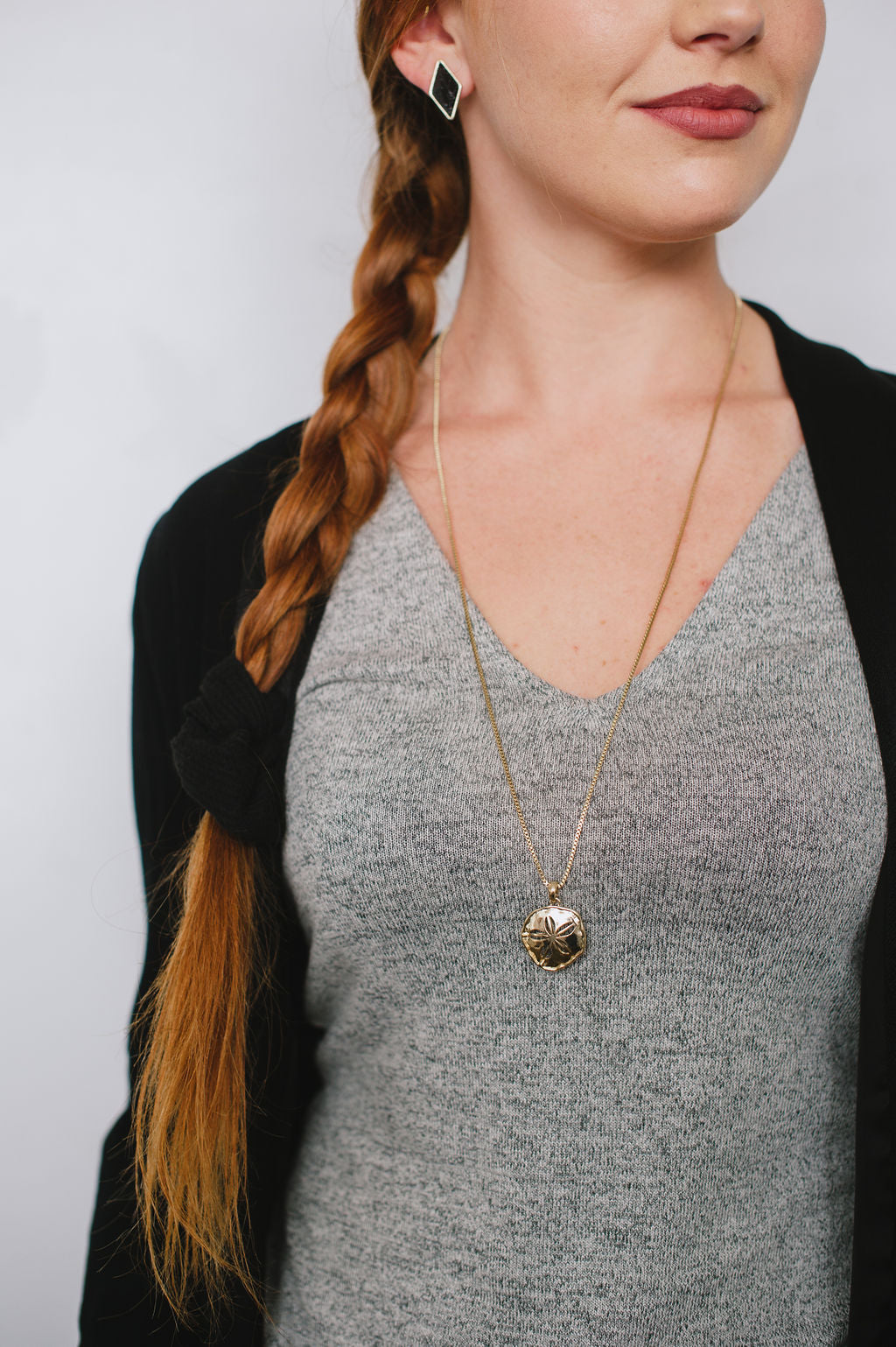 Beck & Boosh Sand Dollar Long Necklace Plated Gold Sand Dollar Pendant Hanging From Long Gold Plated Chain On Model