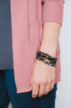 Beck & Boosh Felicity Four Bracelet Set Four Individual Beaded Bracelets with a Mixture of Navy, Black, and Silver Iridescent Beads and a Feature Hexagon Shaped Silver Druzy Pendant On Model