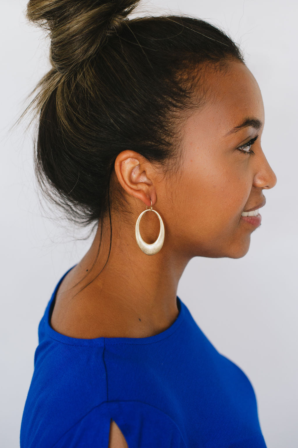 Beck & Boosh Amelia Dangles Hollow Oval Shaped Dangle Earrings Plated Brushed Silver On Model