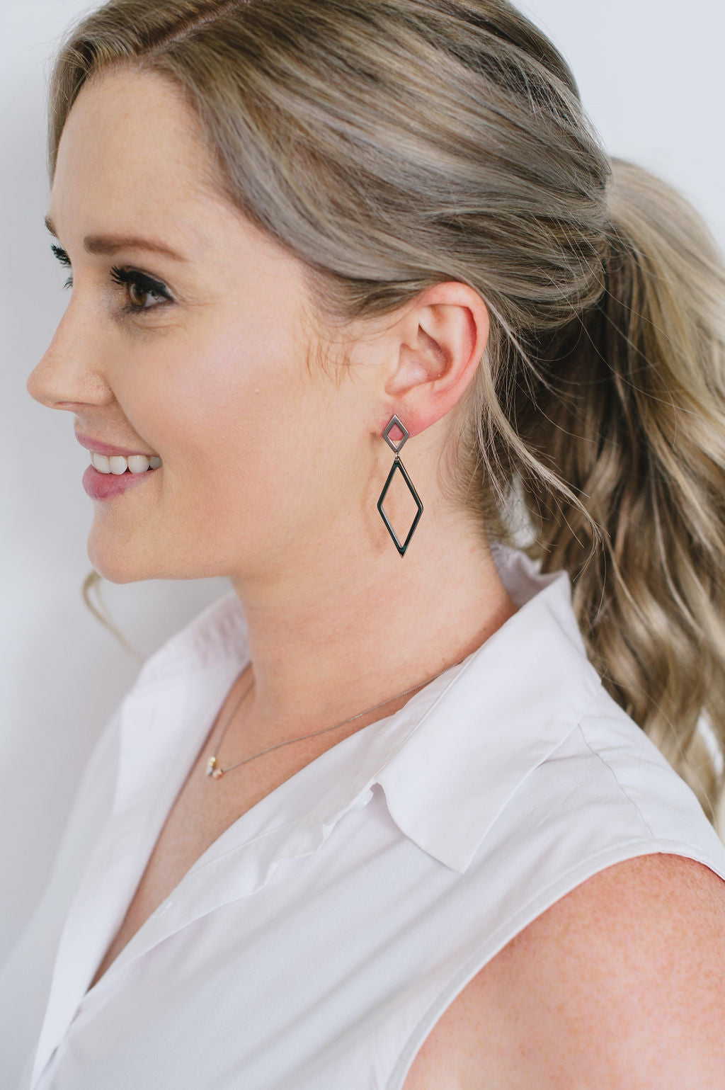 Beck & Boosh Therese Earrings Small Diamond Stud With Larger Diamond Dangling Below Plated Silver Stainless Steel On Model