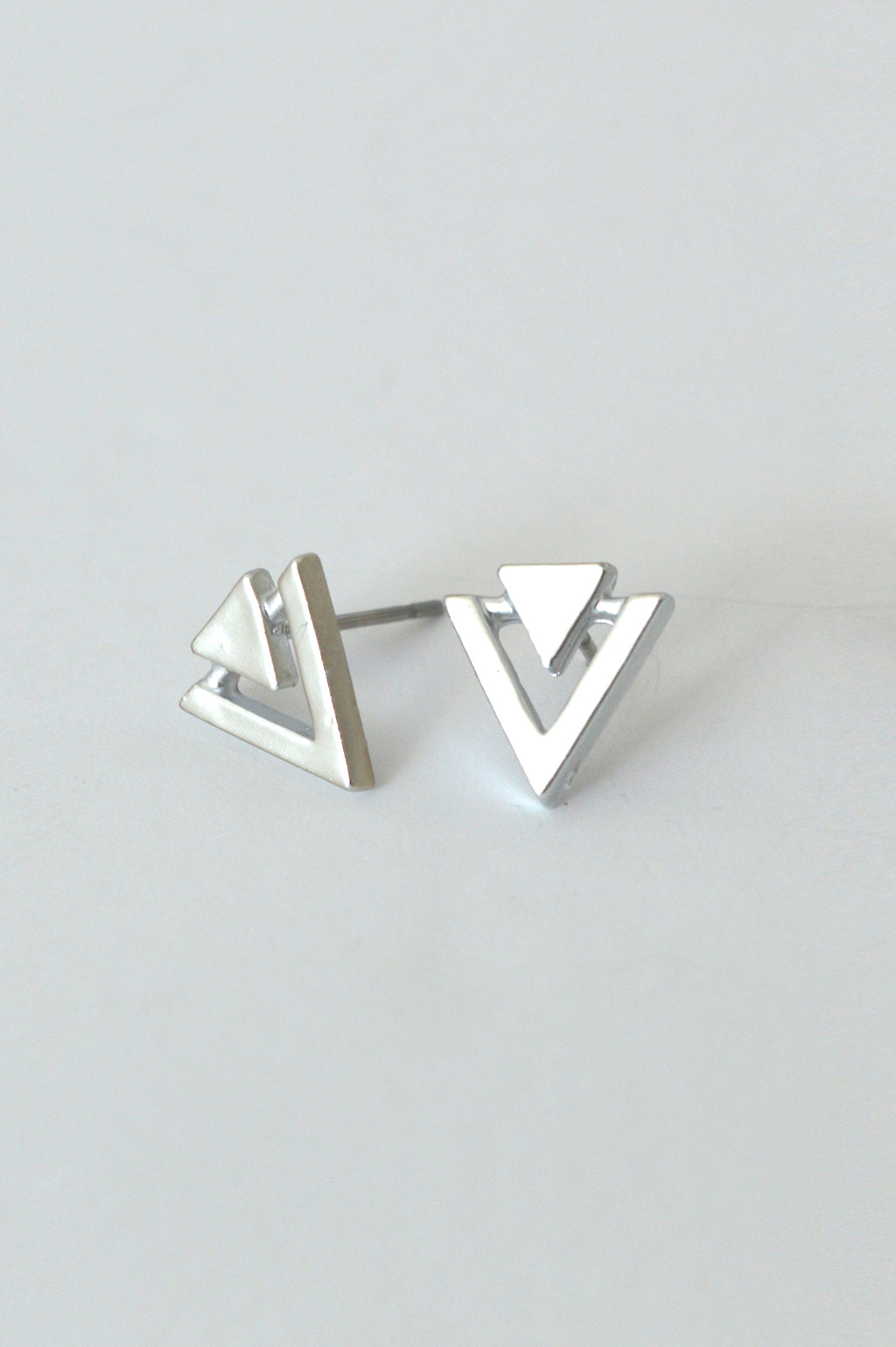 beck & boosh geometric inspired fashion jewelry small silver triangle studs with cut out design in a matte finish