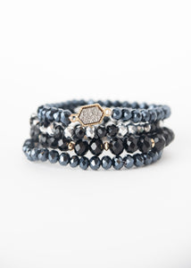 Beck & Boosh Felicity Four Bracelet Set Four Individual Beaded Bracelets with a Mixture of Navy, Black, and Silver Iridescent Beads and a Feature Hexagon Shaped Silver Druzy Pendant