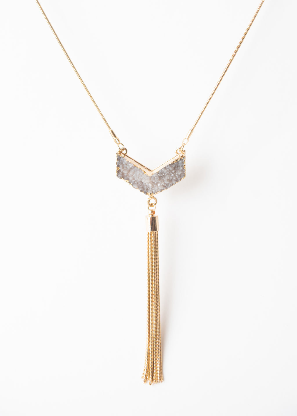 Beck & Boosh Gravity Statement Necklace Long Plated Gold necklace with Grey V-shaped Druzy Pendant with gold chain tassel hanging below