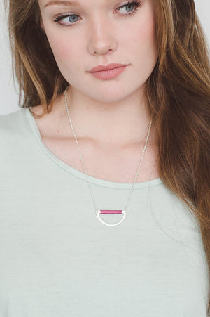 beck & boosh fashion jewelry necklace with a half moon design pendant with pink thread wrapping accent