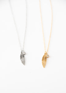 Beck & Boosh Plume & Rhinestone Short Necklace Delicate Feather Pendant with Accompanying Rhinestone Pendant Plated Silver and Gold Stainless Steel