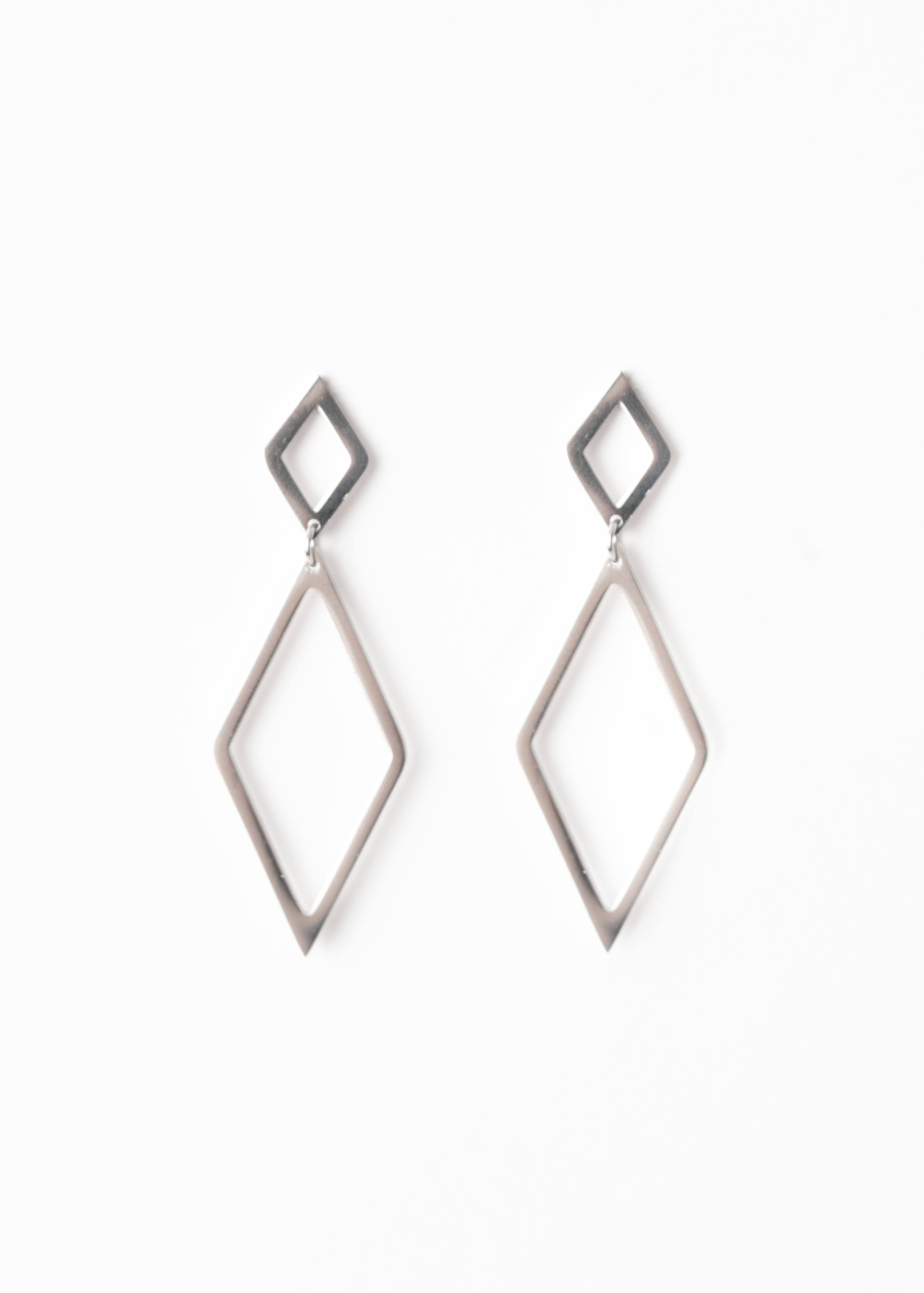 Beck & Boosh Therese Earrings Small Diamond Stud With Larger Diamond Dangling Below Plated Silver Stainless Steel