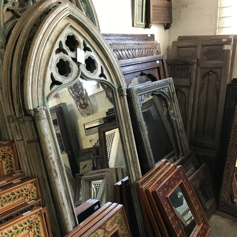 Various ornately carved Indian mango wood and antique mirrors