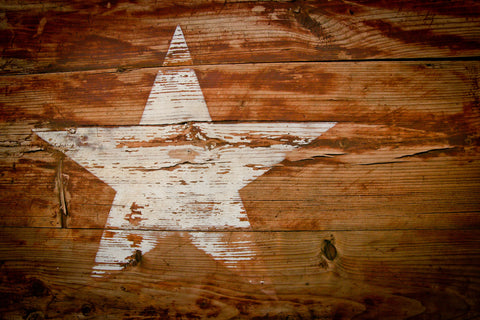 White star painted on wood.