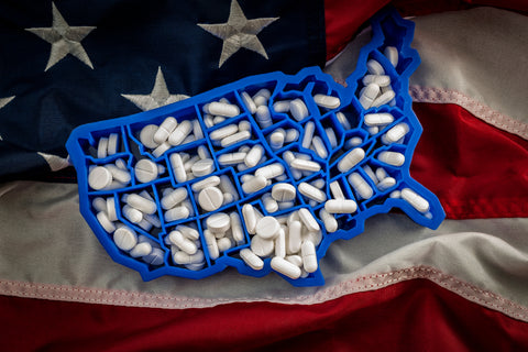 opioid epidemic and drug abuse concept with the map of USA filled with oxycodone and hydrocodone