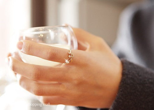 Fashion gilded notes ring