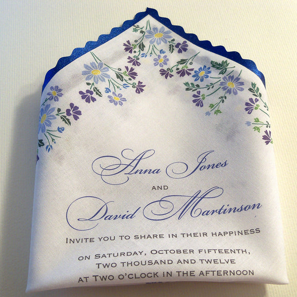 Wedding invitations on handkerchief with blue flowers