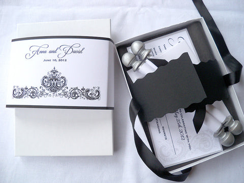 Elegant boxed wedding invitation suite with scroll, reply card and extra insert, antique damask design