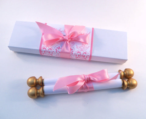 Pink and gold invitation scroll for storybook wedding, boxed