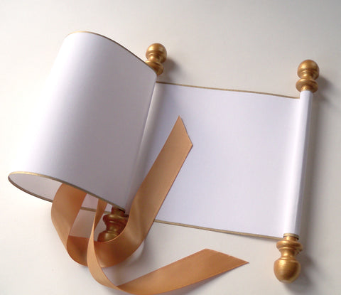 Blank white paper scroll for handwritten wedding vows, gold finials and accents, with white presentation box