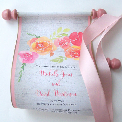 Rustic wedding invitation scrolls on birch tree background with peach and blush pink roses, metallic rose gold wooden finials and ribbon, set of 10