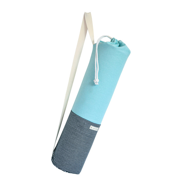Common Texture cotton canvas Do Good Yoga Mat Bag in soothing colors and stripes with shoulder or crossbody carrier strap, drawstring top closure and side pockets.
