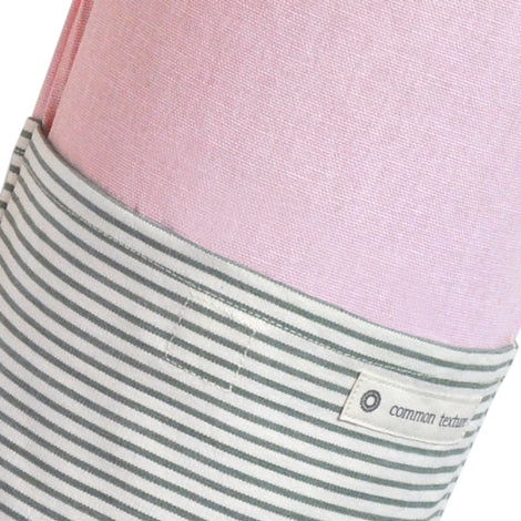 Common Texture cotton canvas Do Good Yoga Mat Bag in pink and light grey stripes with shoulder or crossbody carrier strap, drawstring top closure and side pockets.
