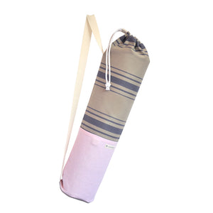 Common Texture cotton canvas Do Good Yoga Mat Bag in pink blue and beige colors and stripes with shoulder or crossbody carrier strap, drawstring top closure and side pockets.