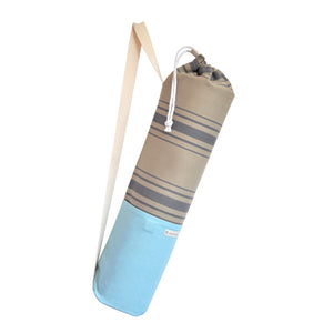 Common Texture cotton canvas Do Good Yoga Mat Bag in blue and beige colors and stripes with shoulder or crossbody carrier strap, drawstring top closure and side pockets.