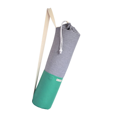 Common Texture cotton canvas Do Good Yoga Mat Bag in green and blue stripes with shoulder or crossbody carrier strap, drawstring top closure and side pockets.