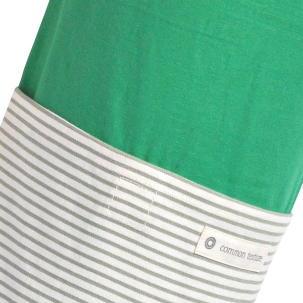 Common Texture cotton canvas Do Good Yoga Mat Bag in green light grey colors and stripes with shoulder or crossbody carrier strap, drawstring top closure and side pockets.