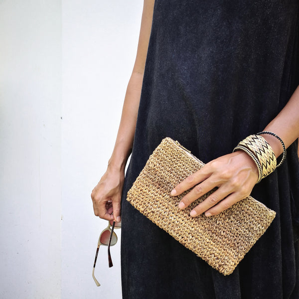 Common Texture handcrafted woven banana fiber clutch bag and rattan bangle bracelet set.