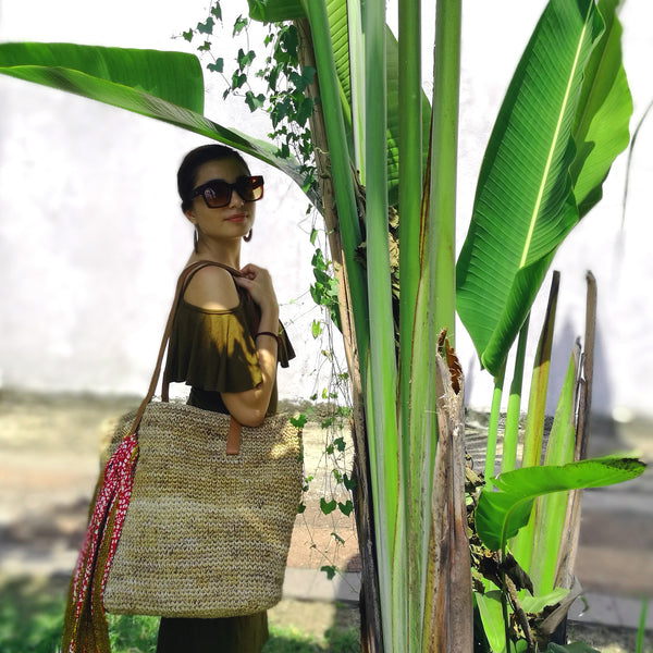 Common Texture large hand woven shopper tote bag made with natural sustainable banana fiber and genuine quality handcrafted leather straps.