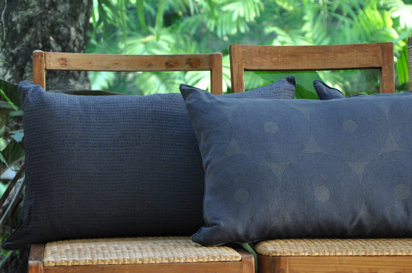 Common Texture lumbar rectangular pure linen cushions featuring hand block printed patterns in indigo blue on dark charcoal grey with contrasting gold zip and leather pull tag.