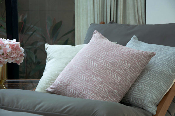 Common Texture square pure linen cushion cover featuring a hand block printed dash pattern in cream on pastel with contrasting gold zip and leather pull tag.