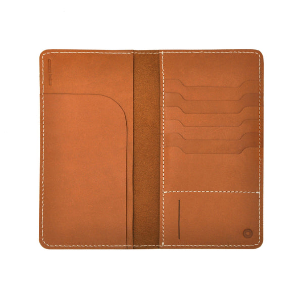 Common Texture slim handcrafted veg tan leather travel wallet for men or women with a practical design to keep passport, boarding pass and travel documents neatly organized.