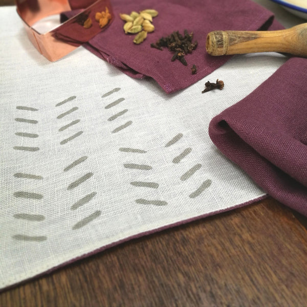 Common Texture hand block printed linen placemat set with matching napkins in sand ecru and red wine muscat.