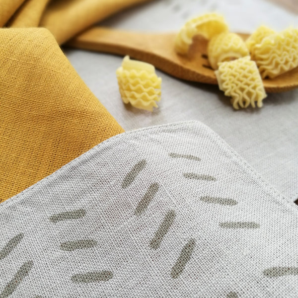 Common Texture hand block printed linen placemat set with matching napkins in stone and turmeric colors