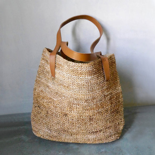Common Texture large hand woven shopper tote market bag made with natural sustainable banana fiber and genuine quality handcrafted leather straps.