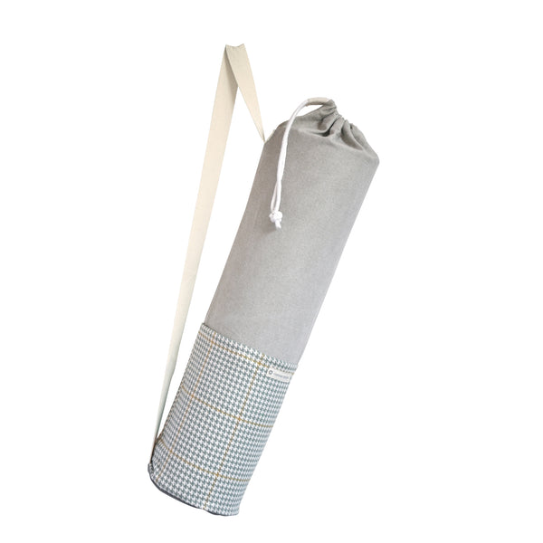 Common Texture cotton canvas Do Good Yoga Mat Bag in grey and neutral colors with a houndstooth pattern, shoulder or crossbody carrier strap, drawstring top closure and side pockets.