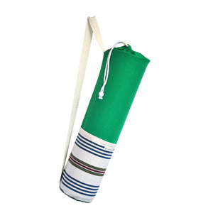 Common Texture cotton canvas Do Good Yoga Mat Bag in bright green colors and stripes with shoulder or crossbody carrier strap, drawstring top closure and side pockets.