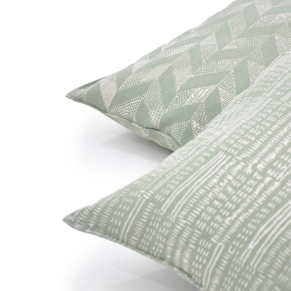 Common Texture square pure linen cushion cover featuring a hand block printed pattern in cream on pastel green with contrasting gold zip and leather pull tag.