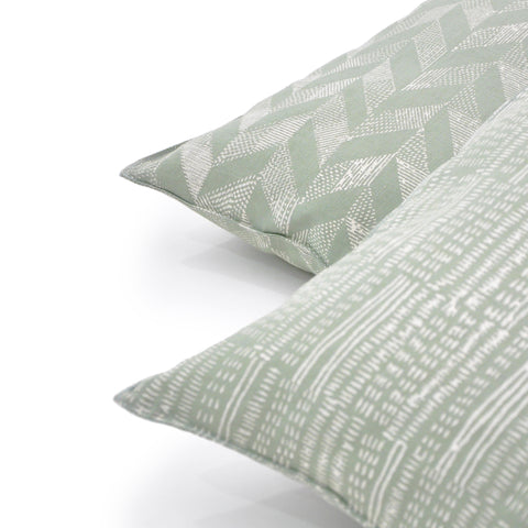 Set of Common Texture Dessin au Pastel linen cushion covers in pastel green with cream hand block printed Dash and Trapeze patterns