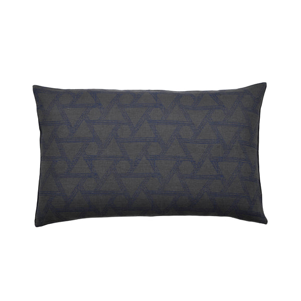 Common Texture lumbar rectangular pure linen cushion cover featuring hand block printed triangles in indigo blue on dark charcoal grey with gold zip and leather pull tag.
