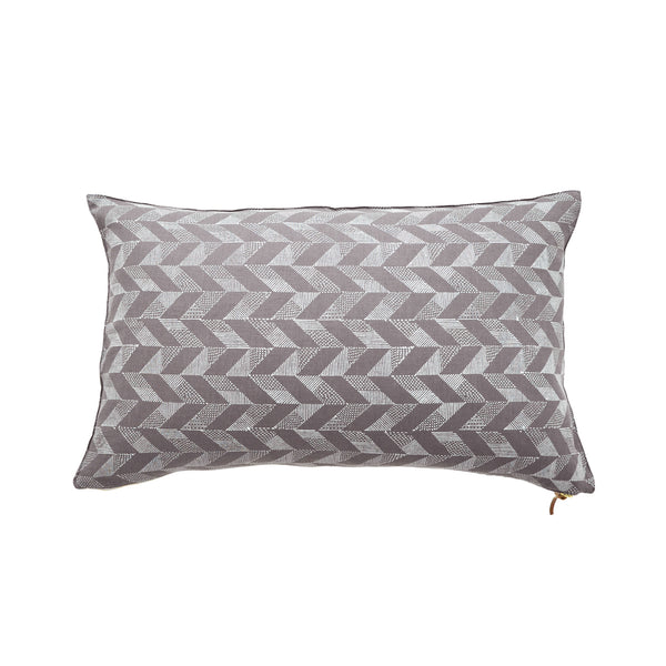 Common Texture lumbar rectangular pure linen cushion cover featuring a hand block printed trapeze pattern in cream on dark grey with contrasting gold zip and leather pull tag.