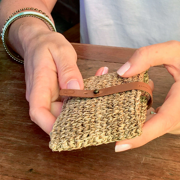 Common Texture handcrafted woven card holder for women made with natural banana fiber and upcycled leather fastener.